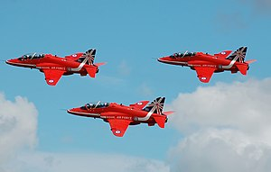 BAE Systems Hawk - The RAF Red Arrows depart the 2014 Royal International Air Tattoo, England, in a colour scheme that commemorates their 50th year.