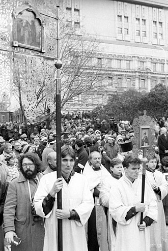 Solovetsky Stone - Gleb Yakunin performing a service for the victims of the Stalinist political repressions during the unveiling of the Solovetsky Stone in Lubyanka Square, Moscow, on October 30, 1990