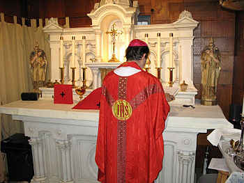 Latin Mass, said wearing a red gothic chasuble...