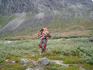 Culture of Greenland - Hunter carrying reindeer meat.
