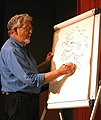 Rolf Harris drawing a self-portrait.jpg