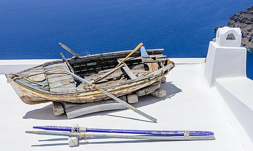 Row boat on a roof in Santorini