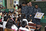 Sailors read to children in the Philippines 121025-N-SF704-052.jpg