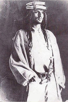 Saud bin Abdul Aziz, eldest son of Abdul Aziz Al-Saud (Ibn Saud) and second King of Saudi Arabia. After spending his early life as a fighter in his father's forces, Saud inherited the Saudi throne in 1953 and changed the state's succession laws to favor direct primogeniture from father to son as opposed to Salic law. After years of internal conflict, he was deposed in 1964 by members of the Saudi clergy and the House of Saud; he was replaced with his half-brother Faisal ibn Abdul Aziz Al-Saud.