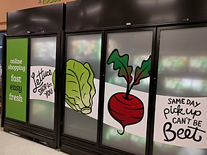 Online grocer - In-store order pickup fridges at a Save-On-Foods store in British Columbia, Canada.