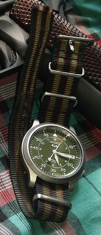 Seiko - A stainless steel Seiko 5 SNK805 with green face and 18mm wide NATO watch strap.