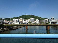 Shimmachigawa River and Mount Bizan from Kachidokibashi Bridge.JPG