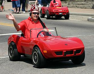 Shriners - A Cincinnati Shriner in an iconic miniature car participating in a Memorial Day parade
