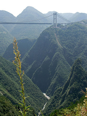 Limited-access road - G50 Huyu Expressway crossing over the Si Du River Bridge in Enshi Prefecture, Hubei, China.
