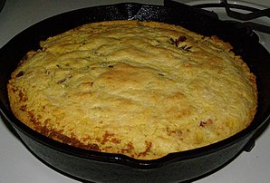 English: Cast iron skillet cornbread with baco...