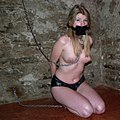 Slave gagged and chained in a dungeon (3212).jpg