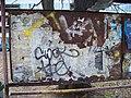 Sokolovská, sídliště Invalidovna, starý přístřešek, tabule na jízdní řády.jpg