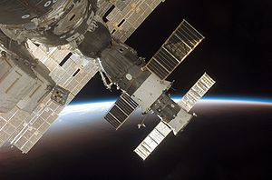 Soyuz TMA-9 - The docked Expedition 13 / Soyuz TMA-9 (foreground) and Progress 22 resupply vehicle are featured in this image photographed by an STS-116 crewmember from a window on the International Space Station while Space Shuttle ''Discovery'' was docked with the station in December 2006. The blackness of space and Earth's horizon provide the backdrop for the scene.