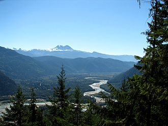 Squamish River - Looking SE down the Squamish Valley 15 miles from its mouth.  Mount Garibaldi at centre, Black Tusk at left .  The town of Squamish is out of view around the mountain at right.