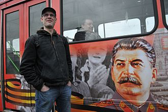 Neo-Stalinism - A Saint Petersburg bus with Stalin's portrait who was included in a montage that commemorated the Soviet Union's victory in the Great Patriotic War