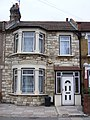Stone cladding with scrolled pediment doorway. Seven Kings.jpg