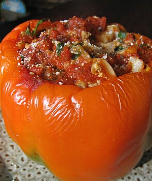 A stuffed orange pepper