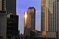 Sunset across building (2717611535).jpg