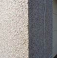 Surfaces vertical wall stone pattern side of a building closeup view.JPG