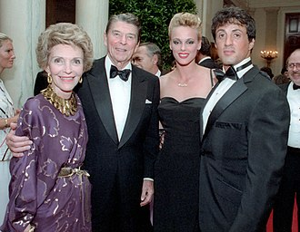 Stallone with then-wife Brigitte Nielsen, President Ronald Reagan and First Lady Nancy Reagan at the White House, 1985 Sylvester Stallone Brigitte Nielsen (cropped).jpg