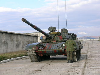 Reactive armour - A T-72 tank layered with reactive armour bricks.