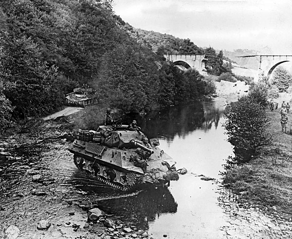 Two American M10 tank destroyers in France during World War II Tank destroyers.jpg