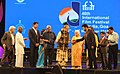 The Chief Guest Actor Anil Kapoor lighting the lamp at the inauguration of the 46th International Film Festival of India (IFFI-2015), in Panaji, Goa. The Governor of Goa, Smt. Mridula Sinha, the Union Minister for Finance.jpg