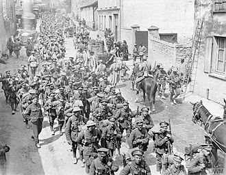 Spring Offensive - French and British troops marching back through Passy-sur-Marne, 29 May 1918.