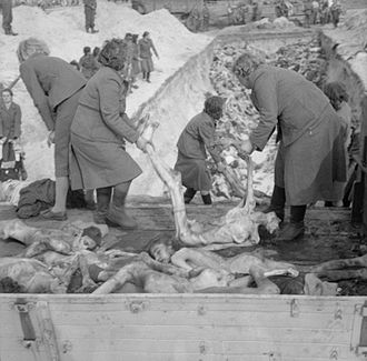 Schutzstaffel (SS) female camp guards removing prisoners' bodies from lorries and carrying them to a mass grave, inside the German Bergen-Belsen concentration camp, 1945 The Liberation of Bergen-belsen Concentration Camp, April 1945 BU4031.jpg