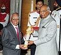 The President, Shri Ram Nath Kovind presenting the Padma Bhushan Award to Dr. Ramachandran Nagaswamy, at the Civil Investiture Ceremony, at Rashtrapati Bhavan, in New Delhi on March 20, 2018.jpg