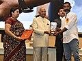 The President, Shri Ram Nath Kovind presenting the Swarna Kamal Award to Nagraj Manjule (Best Direction) for the Non-feature film – PAVASACHA NIBANDHA, at the 65th National Film Awards Function, in New Delhi.JPG