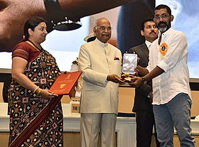 The President, Shri Ram Nath Kovind presenting the Swarna Kamal Award to Nagraj Manjule (Best Direction) for the Non-feature film – PAVASACHA NIBANDHA, at the 65th National Film Awards Function, in New Delhi.JPG