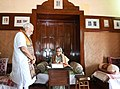 The Prime Minister of Bangladesh, Ms. Sheikh Hasina signing the visitors' book at Santi Niketan, in West Bengal on May 25, 2018. The Prime Minister, Shri Narendra Modi is also seen.JPG