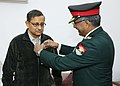 The Secretary, Kendriya Sainik Board, Brig. M.H. Rizvi pinning Armed Forces Flag on the Defence Secretary Sanjay Mitra, IAS.jpg