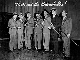 The Untouchables (1959 TV series) - Photo of the cast for The Untouchables as seen on Desilu Playhouse: Only Robert Stack (third from left) and Abel Fernandez (second from right) were used in the actual television series. Keenan Wynn is seen here at the right of Robert Stack, Peter Leeds (who played LaMarr Kane, replaced in the series by Chuck Hicks) is to the right of Wynn, and TV's Kit Carson, Bill Williams as Marty Flaherty (replaced by Jerry Paris in the series), is on the far right. Actor Paul Dubov, who played Jack Rossman (replaced in the series by Steve London), is missing from this photo.