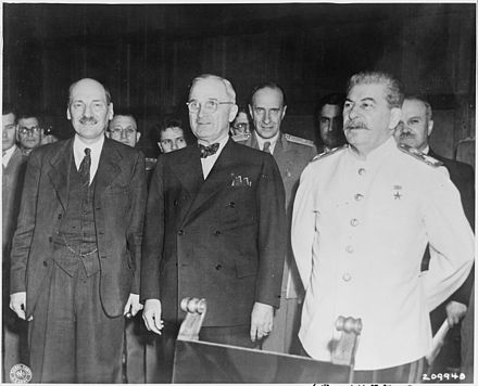 "Clement Attlee, Harry S. Truman and Joseph Stalin at the Potsdam Conference, 1945 The new ""Big Three"" meet for the first time at the Potsdam Conference in Potsdam, Germany. L to R, new British Prime... - NARA - 198950.jpg"