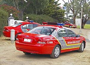 English: Three Australian Federal Police, Ford...
