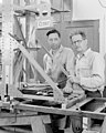 "Tie-in survey device for alpha magnetic field measurement, referred to as ""Cedric."" Laboratory Photographer, Cedric Wright, (far right) shown here with unknown individual, possibly Sam Simmons - NARA 22118558.jpg"