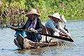 Tonle Sap Siem Reap Cambodian-couple-steering-their-boat-01.jpg