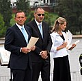 Tony Abbott and Michael Pezzullo at the 2015 National Flag Raising and Citizenship Ceremony.jpg