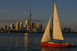 Sailboat passes in front of the Toronto skylin...