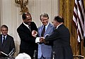 Triple handshake with Carter, Sadat, and Begin in the East Room, September 17, 1978 (10729859923).jpg