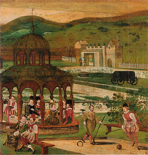 Trucco - Two gentlemen play troco while an elegant company dines in a gazebo. English, early 17th century.