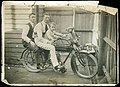 Two men and a young boy (Tom Wild) on a motorbike, with a teddy bear sitting on the handle bars (10544730075).jpg