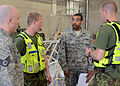U.S. Air Force Master Sgt. Dallas Perry, center right, with the 175th Logistics Readiness Squadron, Maryland Air National Guard, works with Estonian airmen to load equipment at amari Air Base in Estonia 130607-Z-YE885-001.jpg