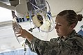 U.S. Air Force Senior Airman Megan Stanton, a medic with the 366th Medical Operations Squadron, hangs a bag of IV fluid for a patient in the urgent care center at Mountain Home Air Force Base, Idaho, July 15 130715-F-NW635-009.jpg
