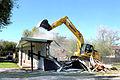 U.S. Air Force Tech. Sgt. Carl White Jr., with the 147th Civil Engineer Squadron (CES), Texas Air National Guard, operates heavy equipment to demolish a drug house in Harlingen, Texas, Dec. 16, 2013 131216-Z-BQ644-004.jpg
