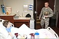 U.S. Air Force Tech. Sgt. Drew Stanley visits Sandra Adams in her room at Integris Southwest Medical Center in Moore, Okla., May 23, 2013 130523-Z-ZW424-007.jpg