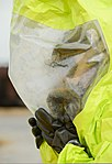 U.S. Air Force Tech. Sgt. Justin Alexander, with the 436th Civil Engineer Squadron, wears a hazardous material suit during a simulated contamination exercise at Dover Air Force Base, Del., Oct. 3, 2013 131003-F-VV898-063.jpg