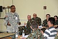 U.S. Army Capt. Carlstein Lutchmedial, left, with the 353rd Civil Affairs Command and a Shared Resilience 2013 instructor, teaches service members about interagency cooperation in Pepeliste, Macedonia, May 28 130528-A-BD830-010.jpg